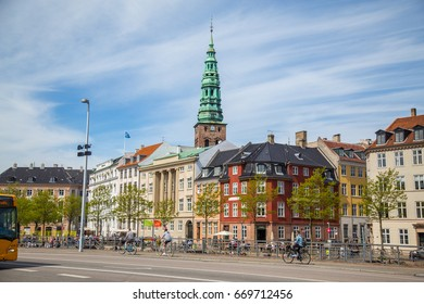 COPENHAGEN, DENMARK - 25TH MAY 2017: Colourful architecture and buildings in central Copenhagen during the day. People can be seen.