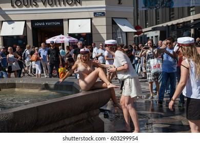 COPENHAGEN, DENMARK - 26 JUN 2016: Students celebrate their high school graduation swimming and dancing in fountain