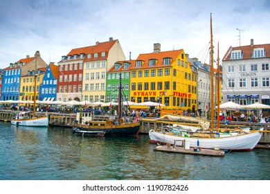 Copenhagen, Denmark - 29 August 2018: Colorful houses and boats on the embankment of the canal in the Nyhavn