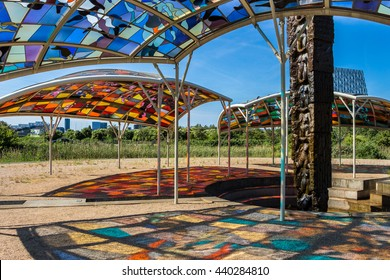 COPENHAGEN, DENMARK - 5 JUNE,2016. Island of Love in Oerestaden - Modern art installation. Stained-glass window on blue sky background. Beautiful view with sun rays of colored light on ground and sand