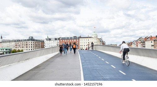 Copenhagen Denmark, 8/12/2018, Cyclists at Kongens Nytorv, cycling city, Copenhagen, bridge crossing