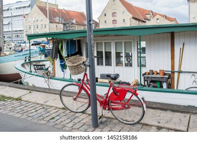Copenhagen Denmark, 8/12/2018, Cyclists at Kongens Nytorv, cycling city, Copenhagen, bicycle in front of the board on the canal.