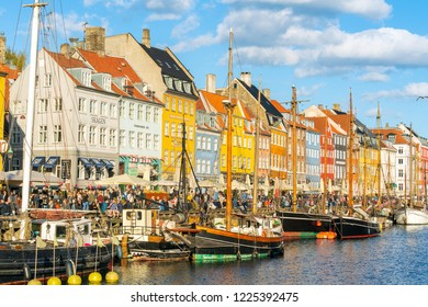 COPENHAGEN, DENMARK -APR 21, 2018: Colorful Buildings at Nyhavn pier district. Nyhavn (New Harbour) is a 17th-century waterfront, canal and entertainment district in Copenhagen, Denmark.