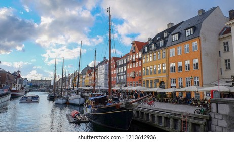Copenhagen / Denmark - April 08, 2016:  The famous colorful pier Nyhavn filled with colorful buildings and boats. Nyhavn is one of the major tourist attractions in Copenhagen