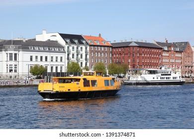 Copenhagen, Denmark - April 15, 2019: Yellow public transportation boat bus in Copenhagen, Denmark