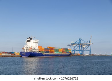 Copenhagen, Denmark - April 18, 2018: Gantry cranes and container ship at Copenhagen container terminal