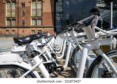 COPENHAGEN, DENMARK - AUGUST 01, 2015: Parked bicycles in the city. A lot of commuters, students and tourists prefer using bike instead of car or bus to move around the city.