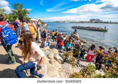 COPENHAGEN, DENMARK - AUGUST 01: Tourists near the iconic statue of The Little Mermaid on August 1, 2015, Copenhagen, Denmark