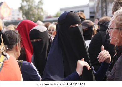 Copenhagen, Denmark - August 1, 2018: Muslim women protest at demonstration against Danish legislation that ban the use of traditional clothes like burqa and niqab.