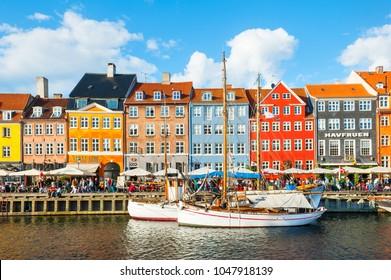 Copenhagen, Denmark - August, 13, 2017: Nyhavn pier with colorful buildings and boats in Copenhagen, Denmark
