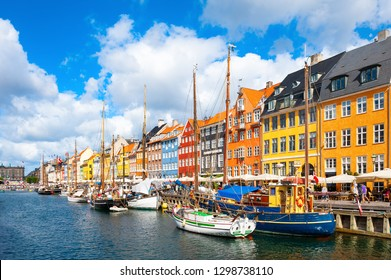 Copenhagen, Denmark - August, 13, 2017: Famous Nyhavn pier with colorful buildings and boats in Copenhagen, Denmark