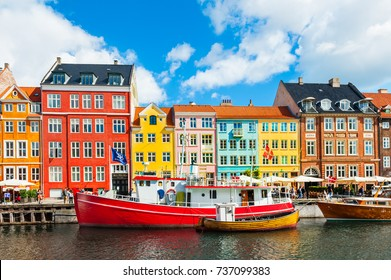 Copenhagen, Denmark - August 13, 2017. Famous Nyhavn pier with colorful buildings and boats in Copenhagen, Denmark