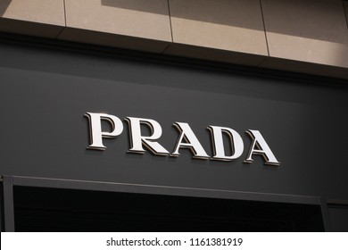 Copenhagen, Denmark - August 17, 2018: Prada logo on front store in shopping street. Prada is a world famous fashion brand founded in Italy.