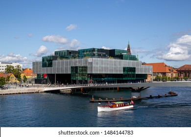 Copenhagen, Denmark - August 21, 2019: The Danish Architecture Center DAC, a modern glass building.