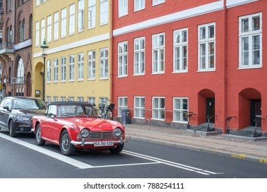 COPENHAGEN, DENMARK - AUGUST 21: Vintage car at Nyhavn on August 21, 2013 in Copenhagen. Nyhavn is a 17th century harbor district and a popular tourist attraction and entertainment district.