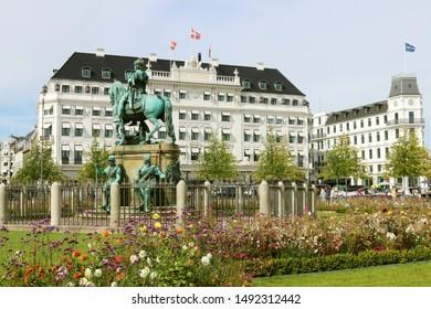 COPENHAGEN, DENMARK - AUGUST 23, 2019: Kongens Nytorv (The King's New Square) - public square in Copenhagen, Denmark. The equestrian statue of Christian V. The Hotel D'Angleterre (England Hotel).