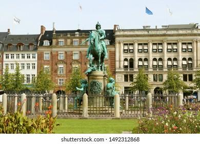 COPENHAGEN, DENMARK - AUGUST 23, 2019: Kongens Nytorv (The King's New Square) - public square in Copenhagen, Denmark. The European Environment Agency (EEA). The equestrian statue of Christian V.