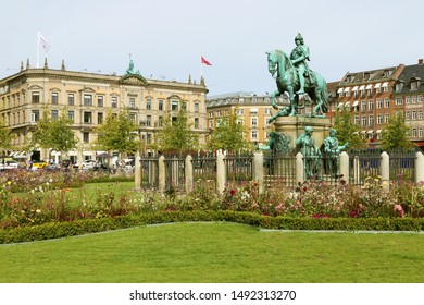 COPENHAGEN, DENMARK - AUGUST 23, 2019: Christian V's equestrian statue at Kongens Nytorv (The King's New Square) is a public square in Copenhagen. In the background Great Northern Telegraph Company.