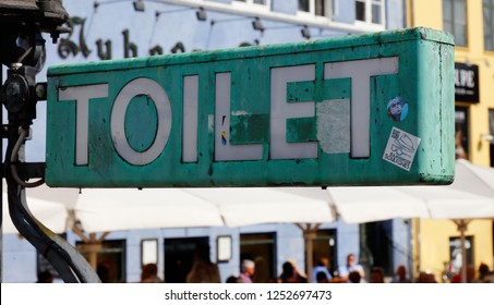 Copenhagen, Denmark - August 24, 2017: Close-up view of a green toilet sign in the Nyhavn area.