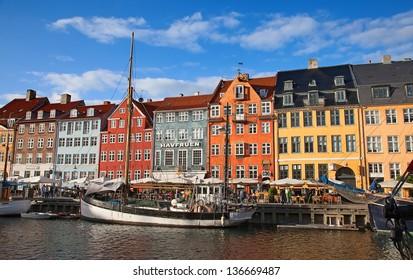 COPENHAGEN, DENMARK - AUGUST 25: unidentified people enjoying sunny weather on the Nyhavn promenade on August 25, 2010 in Copenhagen, Denmark. Nyhavn is one of the most famous landmark of Copenhagen.