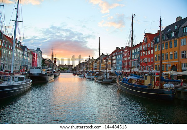 COPENHAGEN, DENMARK - AUGUST 25: unidentified people enjoying evening in open cafes of the Nyhavn on August 25, 2010 in Copenhagen, Denmark.Nyhavn district is most famous landmark of Copenhagen.