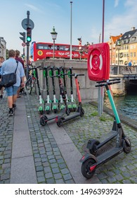 Copenhagen Denmark August 28th 2019 - Scooters for app rental Micromobility in a street in downtown in a sunny summer afternoon