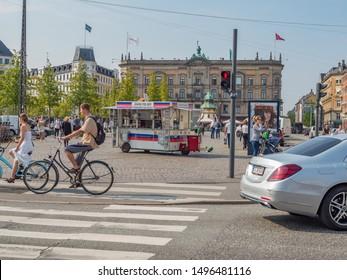 Copenhagen Denmark August 28th 2019 - Joan Polser Hot Dog Kiosk across the road in Kongens Nytorv Park in a sunny summer afternoon