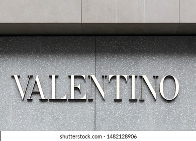 Copenhagen, Denmark - August 3, 2019: Valentino logo on a wall. Valentino is an Italian clothing company founded in 1960 by Valentino Garavani and part of Valentino Fashion Group
