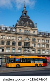 Copenhagen, Denmark - august 4, 2018: Public transport bus and detail of the main façade of the Magasin du Nord warehouse building, built inside an old hotel in the historic center of the city