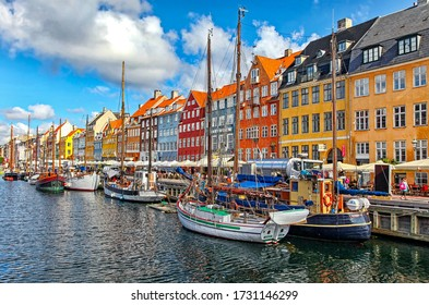 COPENHAGEN, DENMARK - AUGUST 8, 2012: Colorful houses and boats in water canal in famous old town Nyhavn in centre of city