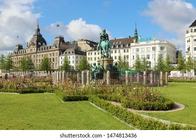 COPENHAGEN, DENMARK - AUGUST 9, 2019: Kongens Nytorv (The King's New Square) is a public square in Copenhagen, Denmark. The department store Magasin du Nord. Super popular shopping. Equestrian statue.