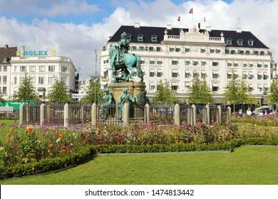 COPENHAGEN, DENMARK - AUGUST 9, 2019: Kongens Nytorv (The King's New Square) is a public square in Copenhagen, Denmark.The Hotel D'Angleterre (England Hotel).Michelin restaurant.The equestrian statue.