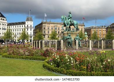 COPENHAGEN, DENMARK - AUGUST 9, 2019: Kongens Nytorv (The King's New Square) is a public square in Copenhagen, Denmark. The equestrian statue of Christian V.