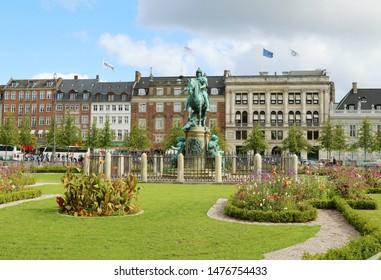COPENHAGEN, DENMARK - AUGUST 9, 2019: Kongens Nytorv (The King's New Square) - public square in Copenhagen, Denmark. The European Environment Agency (EEA). The equestrian statue of Christian V.