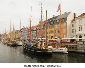 COPENHAGEN, DENMARK - CIRCA JUNE 2016: Pictorial view of the old port Nyhavn (actually meaning  New Port), popular touristic landmark of Copenhagen, built in 17th-century