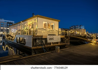 COPENHAGEN, DENMARK - DECEMBER 2017: Houseboat turned into Restaurant Vandvid in the new modern housing development in the southern part of the port of Copenhagen called Sydhavnen.