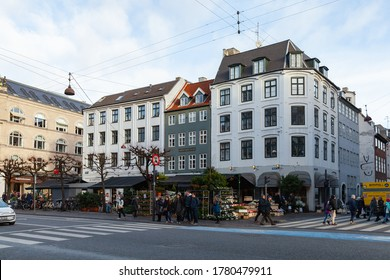 Copenhagen, Denmark - December 9, 2017: Street view of the Magasins Torv, city square with walking people at winter day