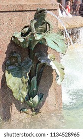 Copenhagen, Denmark  - Detail of  the stork fountain built in 1894 in Armagetorv in central Copenhagen, bronze frog on a leaf