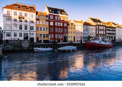 Copenhagen, Denmark - Feb  14 2021: Popular tourists place in Copenhagen, Nyhavn canal. Frozen Nyhavn canal.