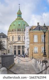 Copenhagen, Denmark - Feb 16, 2020: Amalienborg, 18th-century rococo complex of palaces.