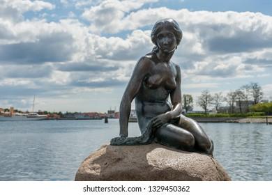 COPENHAGEN, DENMARK - FEBRUARY 15, 2019: The sculpture of the little Mermaid in Copenhagen harbour