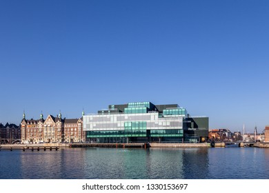 Copenhagen, Denmark - February 27, 2019: The Danish Architecture Center DAC, a modern glass building