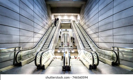 Copenhagen, Denmark - January 20, 2017: People on escalators at Forum metro station