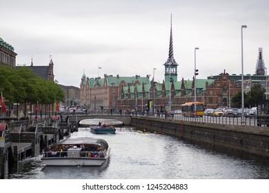 Copenhagen, Denmark - July 1, 2017: The old stock exchange building and boats on Slotsholmen Canal