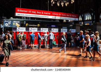 COPENHAGEN, DENMARK - JULY 12, 2018: Passengers are buying train tickets at the main terminal of Copenhagen central station,  the largest railway station in Denmark.