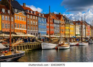 COPENHAGEN, DENMARK - JULY 20, 2017: Beautiful colorful houses and boat in the Nyhavn district in Copenhagen, the capital of Denmark