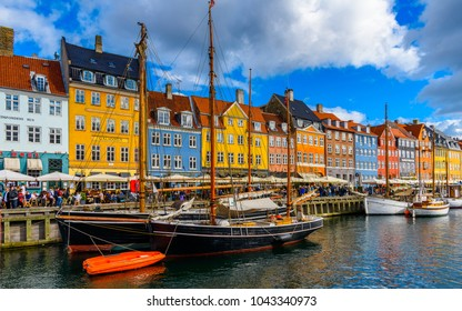 COPENHAGEN, DENMARK - JULY 20, 2017: Beautiful colorful houses and boat in the Nyhavn district in Copenhagen, the capital of Denmark