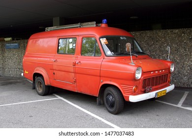 Copenhagen, Denmark - July 20, 2019: Ford Transit MK1 Fire truck parked on a public parking lot. Nobody in the vehicle.