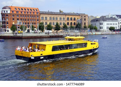 Copenhagen, Denmark - July 20, 2019: Yellow public city harbour bus in the city of Copenhagen.