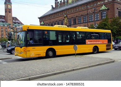 Copenhagen, Denmark - July 20, 2019:  Yellow public transport bus in the city of Copenhagen.
